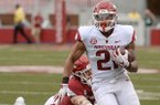 Arkansas running back Devwah Whaley (21) carries the ball Saturday, April 6, 2019, during the Razorbacks' spring game in Razorback Stadium in Fayetteville.