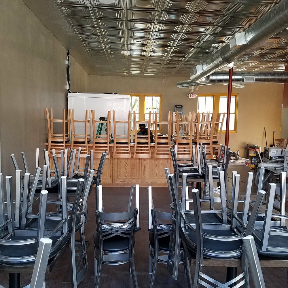 The seating is ready for customers at Stone's Throw Brewing's Stifft Station Taproom. Special to the Democrat-Gazette