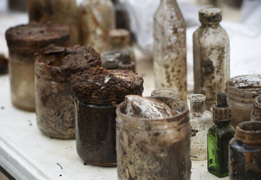 Jars and bottles excavated from a trash pit in the backyard of the Crescent Hotel in Eureka Springs await further attention Thursday.