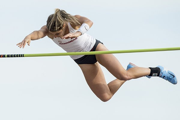 Tori Hoggard of Arkansas clears the bar at 14 feet 6 1/4 inches Friday, April 12, 2019, during the women's pole vault at the John McDonnell Invitational at John McDonnell field in Fayetteville. Hoggard won the event.