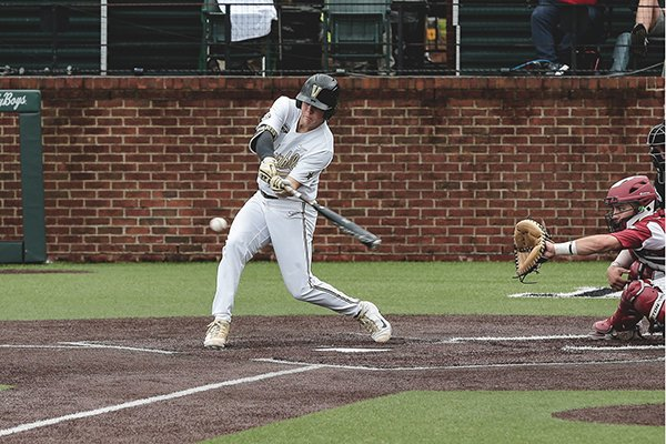 Vanderbilt's Stephen Scott swings during a game against Arkansas on Saturday, April 13, 2019, in Nashville, Tenn.
