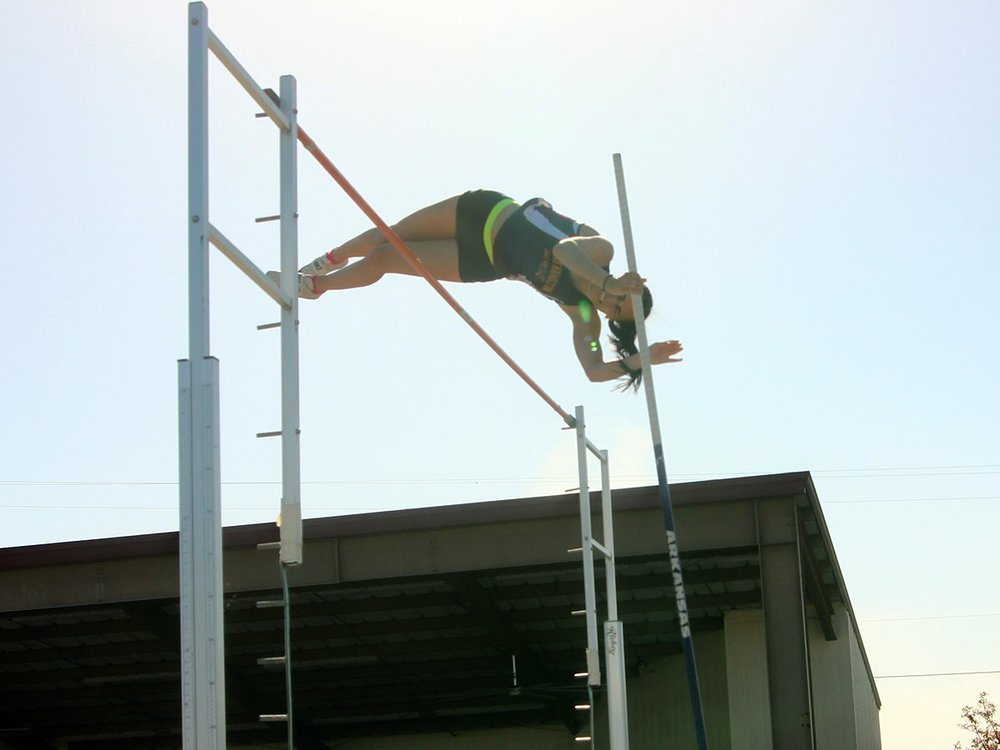 The Sentinel-Record/James Leigh HIGH-FLYING SENIOR: Lake Hamilton senior pole vaulter Edie Murray clears the bar at 12 feet during the Lake Hamilton Invitational on Friday. Murray won the event with the clearance.