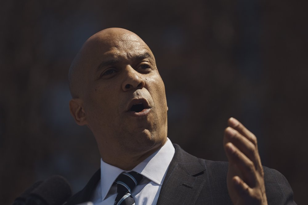 Democratic presidential candidate Sen. Cory Booker, D-N.J. talks to the crowd during a hometown kickoff for his national presidential campaign tour at Military Park in downtown Newark, Saturday, April 13, 2019. (AP Photo/Andres Kudacki)