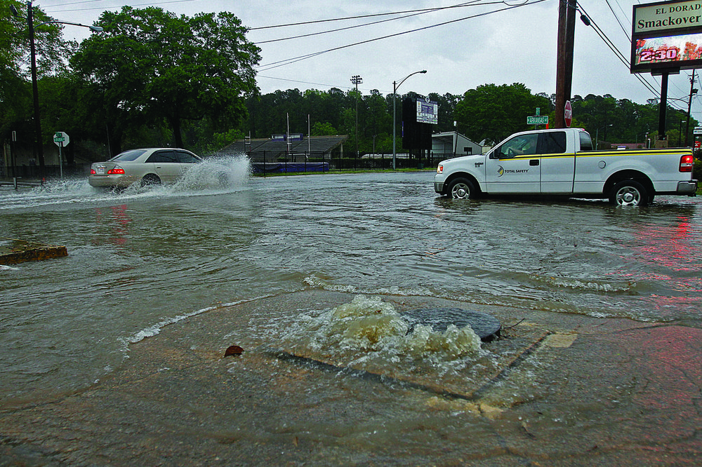 Overflow: Vehicles battle high water along East Fifth Street and Arkansas Street after heavy rains inundated roads.