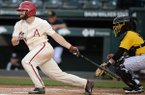 Arkansas second baseman Trevor Ezell connects with the ball Tuesday, April 16, 2019, during the second inning against Arkansas-Pine Bluff at Baum-Walker Stadium in Fayetteville.