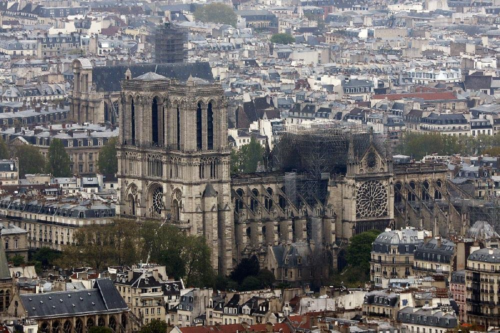 A photo taken from the Montparnasse Tower on Tuesday shows the damage to the top of Notre Dame Cathedral.