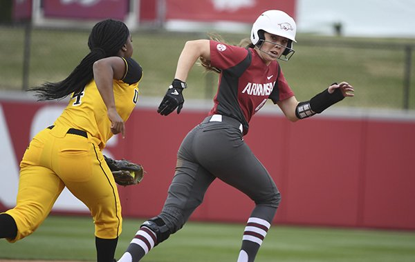 Arkansas baserunner Danielle Gibson tries to avoid the tag from Arkansas-Pine Bluff infielder Alexandria Taylor as she gets caught in a run down during an NCAA softball game on Tuesday, April 16, 2019 in Fayetteville. (AP Photo/Michael Woods)