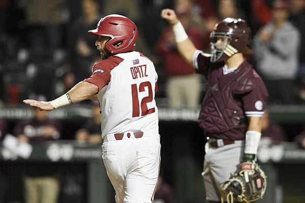 Arkansas catcher Casey Opitz runs to home plate to score a run during the sixth inning of a game against Mississippi State on Thursday, April 18, 2019, in Fayetteville.