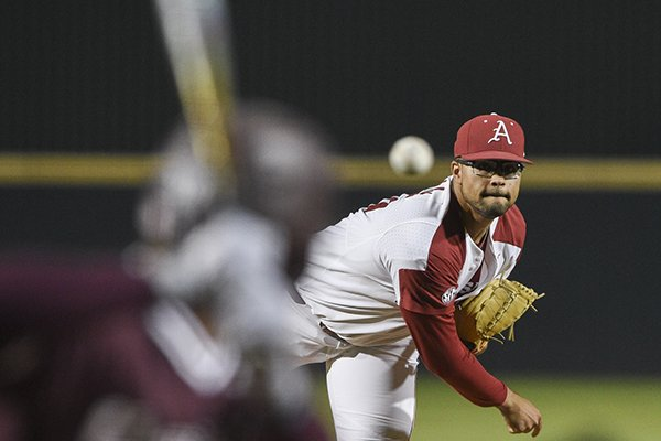 Arkansas pitcher Isaiah Campbell throws to a Mississippi State batter during a game Thursday, April 18, 2019, in Fayetteville.