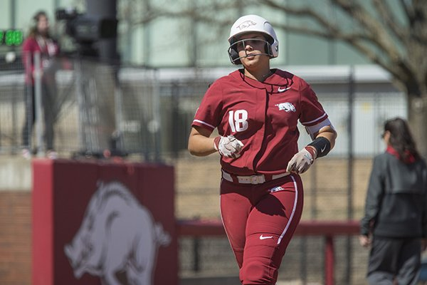 Arkansas' Ashley Diaz runs the bases after hitting a home run during a game against South Carolina on Sunday, March 17, 2019, in Fayetteville.