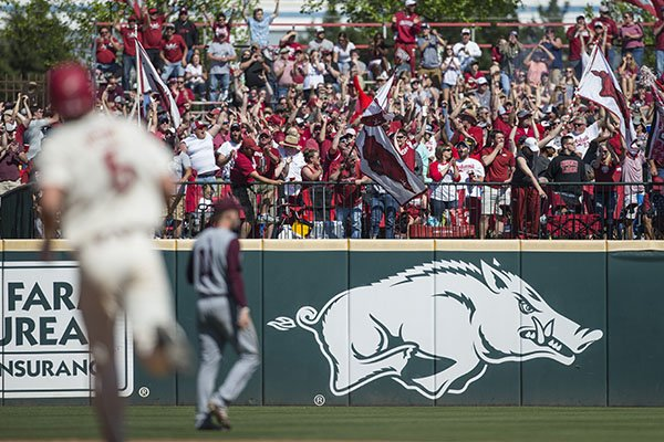 Fans cheer as Arkansas third baseman Jacob Nesbit runs the bases after hitting a three-run home run in the sixth inning of a game against Mississippi State on Saturday, April 20, 2019, at Baum-Walker Stadium in Fayetteville.