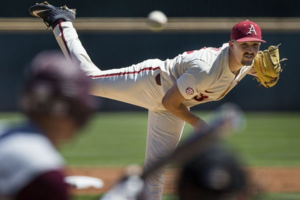 Arkansas pitcher Connor Noland throws during a game against Mississippi State on Saturday, April 20, 2019, in Fayetteville.