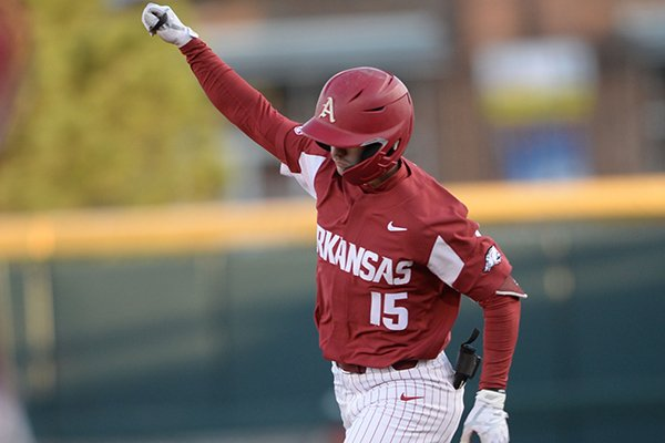 Arkansas shortstop Casey Martin celebrates after hitting a grand slam during a game against Mississippi State on Friday, April 19, 2019, in Fayetteville.