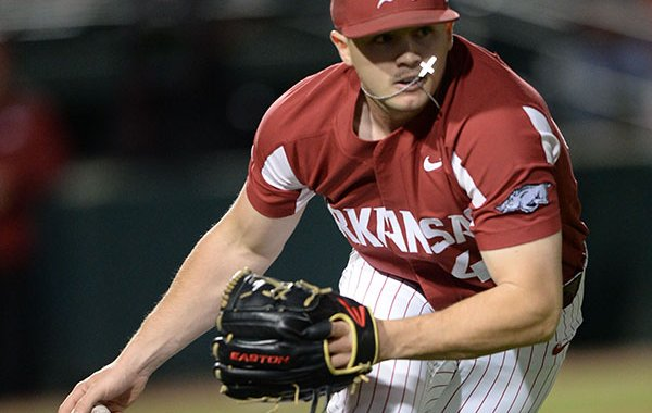 Arkansas pitcher Kevin Kopps fields a ball during a game against Mississippi State on Friday, April 19, 2019, in Fayetteville.