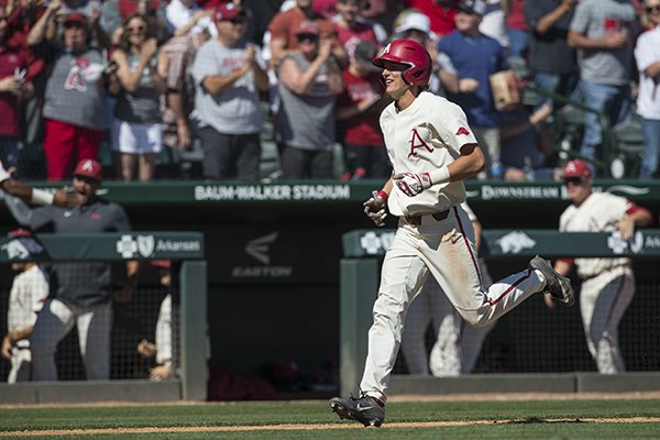 Jacob Nesbit, Arkansas third baseman, runs the bases after hitting a 3 RBI home run in the 6th inning vs Mississippi State Saturday, April 20, 2019, during the game at Baum-Walker Stadium in Fayetteville.