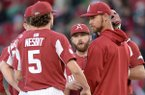 Arkansas pitching coach Matt Hobbs speaks Friday, April 19, 2019, with starter Patrick Wicklander during the third inning against Mississippi State at Baum-Walker Stadium in Fayetteville.