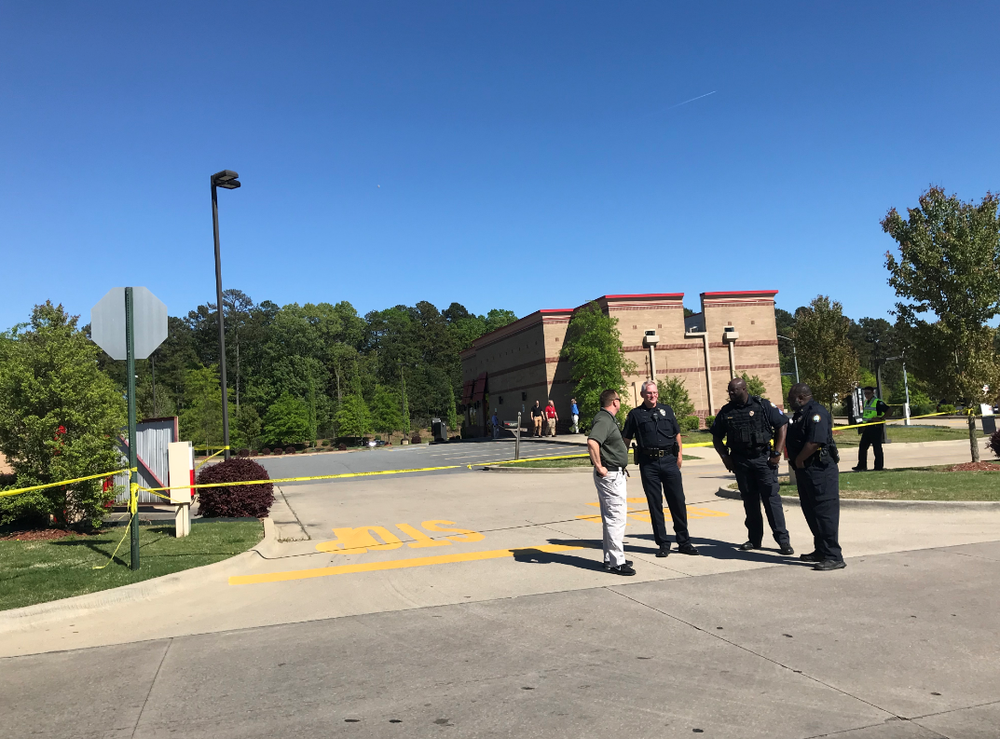 Authorities investigate an officer-involved shooting in the area of a west Little Rock shopping center.