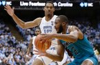 North Carolina's Garrison Brooks (15) guards UNC Wilmington's Jeantal Cylla (2) during the second half of an NCAA college basketball game in Chapel Hill, N.C., Wednesday, Dec. 5, 2018. North Carolina won 97-69. (AP Photo/Gerry Broome)