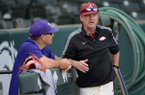 Arkansas coach Dave Van Horn (right) talks with Northwestern State coach Bobby Barbier prior to a game Tuesday, April 23, 2019, in Fayetteville.