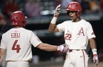 Arkansas outfielder Curtis Washington (22) is congratulated at the plate by second baseman Trevor Ezell after Washington hit a home run - his first as a Razorback - on Tuesday, April 23, 2019, during the seventh inning against Northwestern State at Baum-Walker Stadium in Fayetteville.