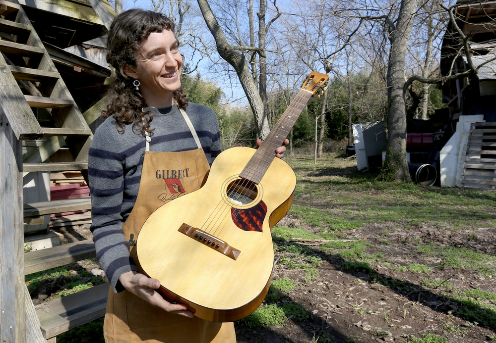Aviva Steigmeyer learned guitar repair after her guitar was stolen and was soon building her own. (NWA Democrat-Gazette/DAVID GOTTSCHALK)