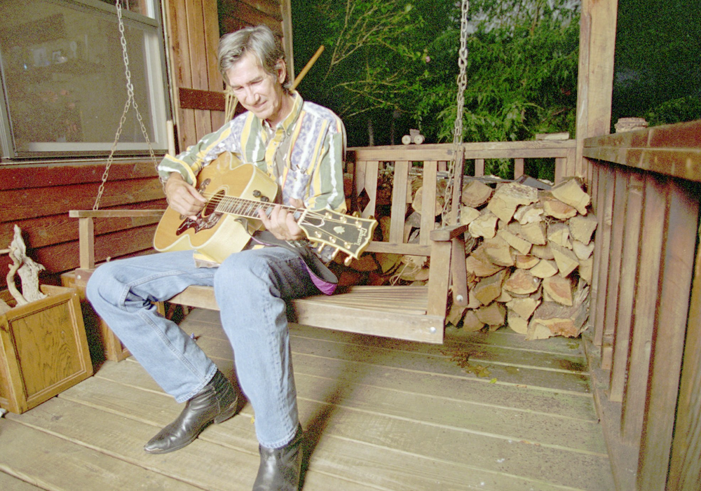 """Townes Van Zandt, writer of """"If I Needed You"""" and """"Pancho & Lefty,"""" picks a tune on the porch in 1995. The singer-songwriter died in 1997. (AP photo)"""
