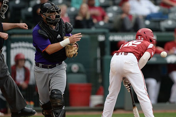 Arkansas catcher Casey Opitz (right) reacts after striking out with a runner in scoring position Wednesday, April 24, 2019, to end the seventh inning against Northwestern State at Baum-Walker Stadium in Fayetteville.