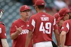 Arkansas coach Dave Van Horn counsels reliever Liam Henry (49) Wednesday, April 24, 2019, after giving up a run during the eighth inning against Northwestern State at Baum-Walker Stadium in Fayetteville.