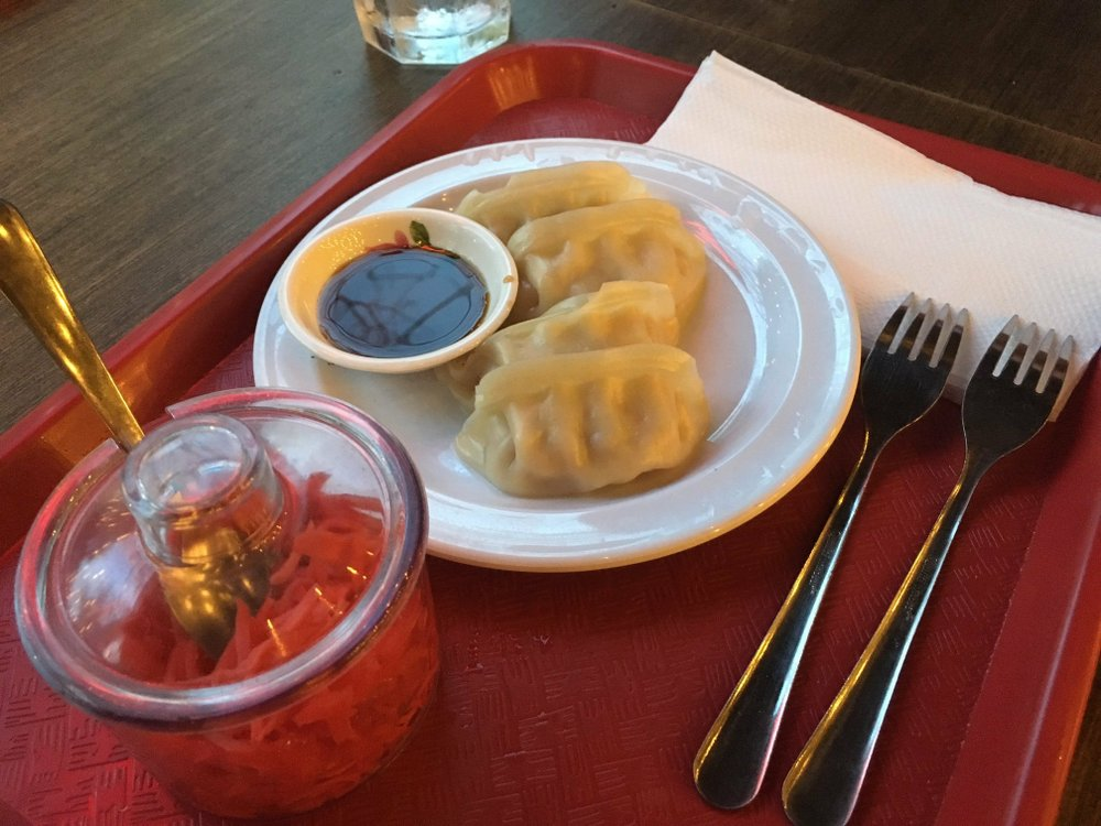 Steamed gyoza and soy sauce, an appetizer at That Ramen Place, comes with a pot of fresh sliced ginger. Arkansas Democrat-Gazette/Karen Martin