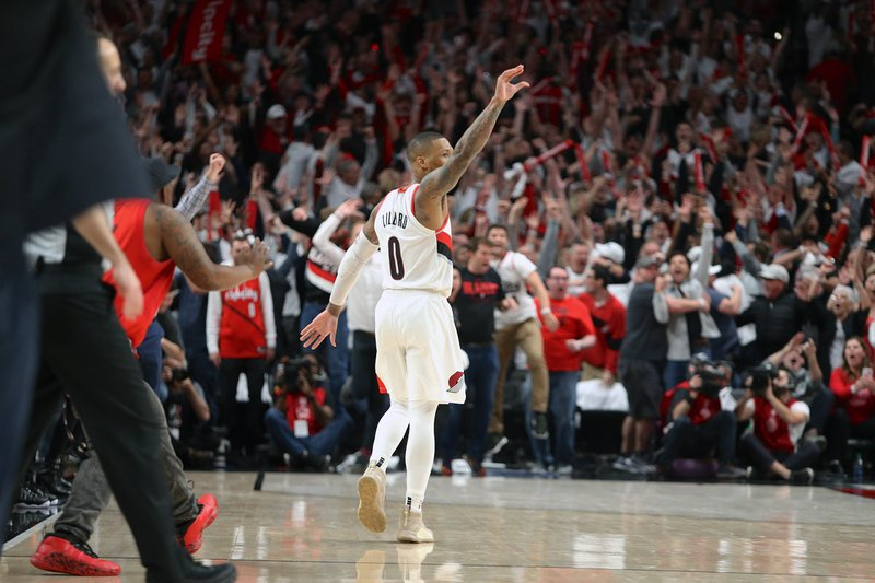 c9f477f391d Portland Trail Blazers  Damian Lillard gestures after shooting the  game-winning three-pointer to beat the Oklahoma City Thunder 118-115 in  Game 5 of their ...