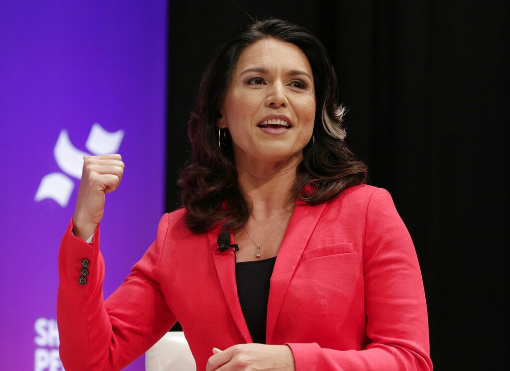 Democratic presidential candidate Rep. Tulsi Gabbard, D-Hawaii, answers questions during a presidential forum held by She The People on the Texas State University campus Wednesday, April 24, 2019, in Houston. (AP Photo/Michael Wyke)