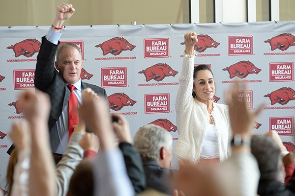 Newly hired Arkansas gymnastics coach Jordyn Wieber (right) calls the Hogs Thursday, April 25, 2019, alongside Hunter Yurachek, director of athletics, during a ceremony in the Bev Lewis Center for Women's Athletics on the University of Arkansas campus in Fayetteville.