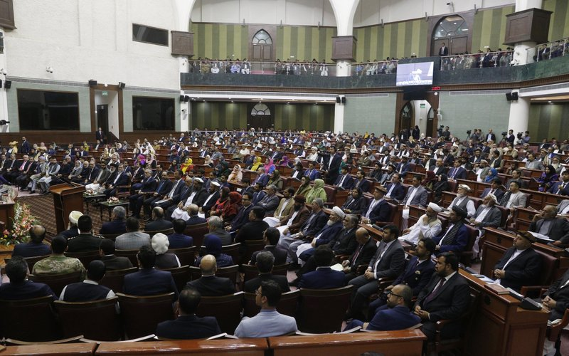 Afghan assembly sworn in after delays, fighting