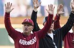 Arkansas coach Dave Van Horn calls the Hogs with members of the Razorbacks' 1979 and 2009 College World Series teams prior to a game against Tennessee on Saturday, April 27, 2019, in Fayetteville.