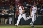 Arkansas first baseman Trevor Ezell runs past third base coach Nate Thompson after Ezell hit a home run during a game against Tennessee on Friday, April 26, 2019, in Fayetteville.