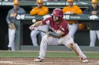 Arkansas first baseman Trevor Ezell bunts during a game against Tennessee on Saturday, April 27, 2019, in Fayetteville.