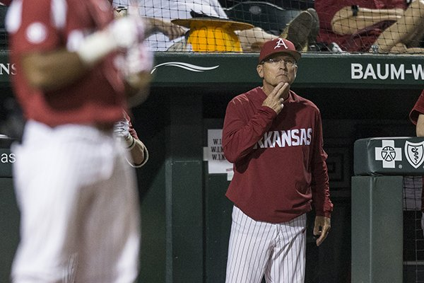 Arkansas coach Dave Van Horn motions from the dugout during a game against Tennessee on Saturday, April 27, 2019, in Fayetteville.