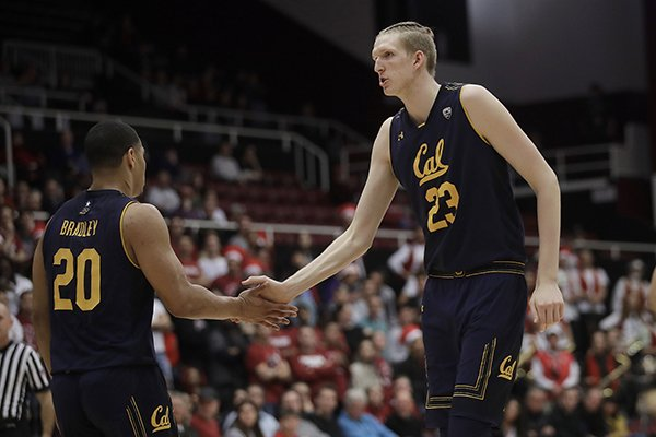 California guard Matt Bradley (20) celebrates with center Connor Vanover (23) during the first half of the team's NCAA college basketball game against Stanford in Palo Alto, Calif., Thursday, March 7, 2019. (AP Photo/Jeff Chiu)