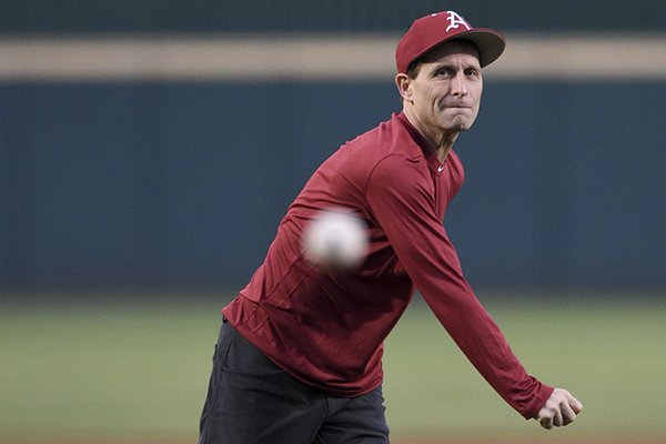 New Arkansas basketball coach Eric Musselman throws the ceremonial first pitch prior to the Razorbacks' baseball game against Mississippi State on Thursday, April 18, 2019, in Fayetteville.