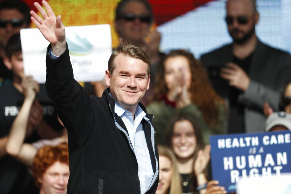 In this Oct. 24, 2018, file photo, U.S. Senator Michael Bennet, D-Colo., greets voters during a rally with young voters on the campus of the University of Colorado in Boulder, Colo.  (AP Photo/David Zalubowski, File)