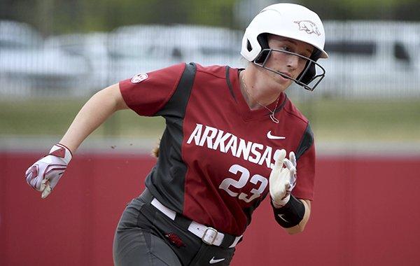 Arkansas baserunner Hannah McEwen rounds third base to score a run against Arkansas-Pine Bluff during an NCAA softball game on Tuesday, April 16, 2019 in Fayetteville. (AP Photo/Michael Woods)