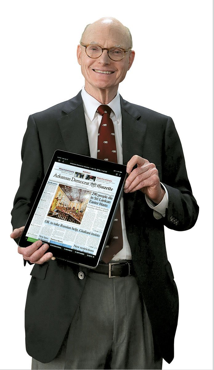 Walter Hussman, publisher of the Arkansas Democrat-Gazette, shows what the digital replica edition of the newspaper looks like. (Arkansas Democrat-Gazette/ JOHN SYKES JR.)