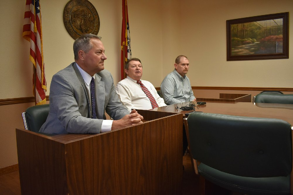 Sevier County officials answer questions during a press conference Thursday about the fate of De Queen Medical Center Inc. From left are Sevier County Rural Development Authority Chariman Dr. Steve Cole, Sevier County Judge Greg Ray and De Queen Mayor Jeff Brown.