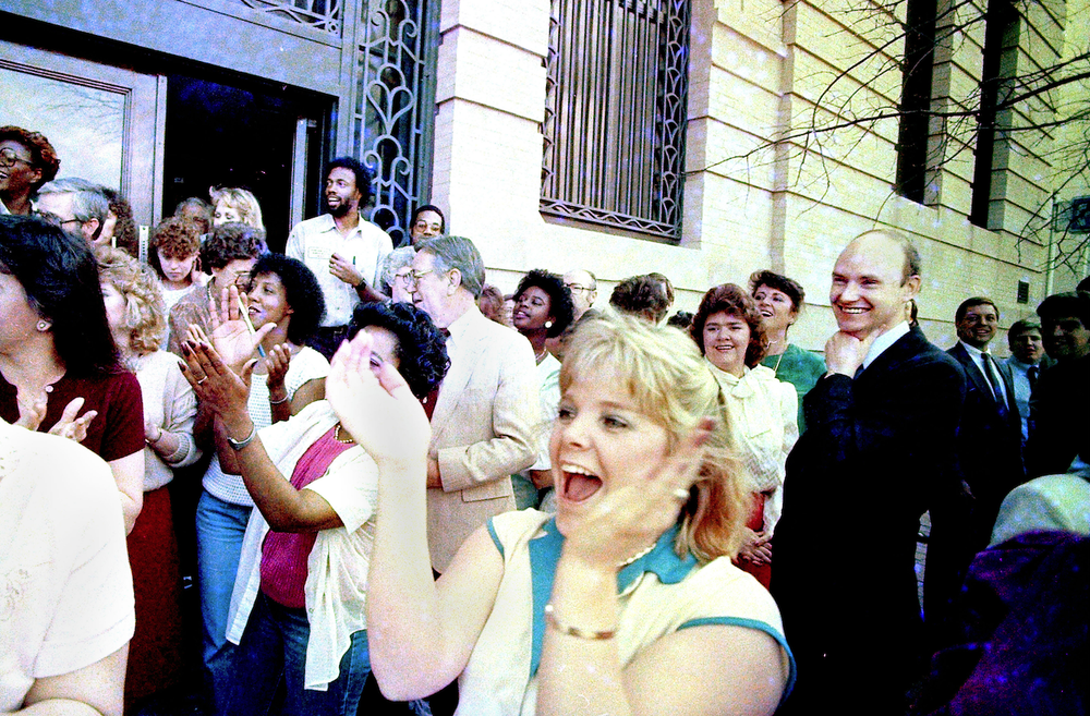 Walter Hussman, far right, celebrates with employees on March 28, 1986, after a jury in federal court found the company not guilty in an antitrust suit brought by the Arkansas Gazette. (Arkansas Democrat-Gazette file photo)