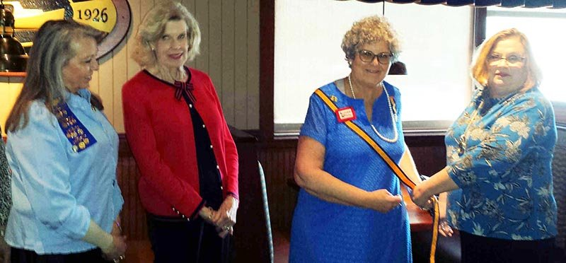 "Submitted photo SASHING: Outgoing Governor Lisa Winkleman ""sashes"" the new governor as Kay Tatum and Barbara Rogers look on."