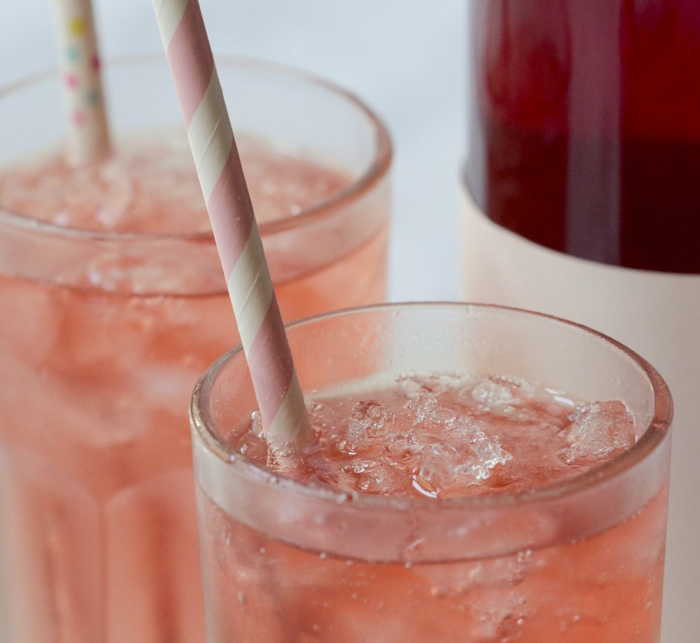 Strawberry-Infused Vodka combined with club soda or tonic water is light and refreshing and a little boozy.