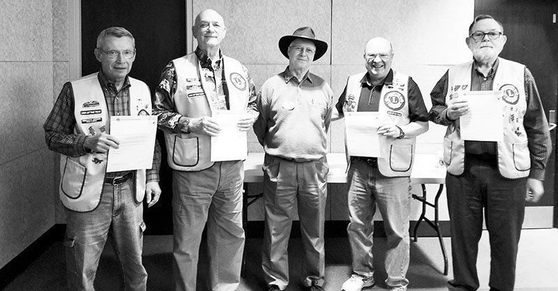Submitted photo SERVICE AWARDS: South Hot Springs Lions Club recently celebrated years of service for several members of the club. From left are Lion Donnie Plummer, 45 years, Lion Lee Floyd, 20 years, Lion Don Draper, district governor, Lion Larry Louden, 10 years, and Lion Dave Osborne, 45 years.