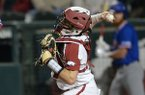 Arkansas catcher Casey Opitz attempts to throw out a base runner during a game against Louisiana Tech on Friday, March 8, 2019, in Fayetteville.