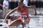 Arkansas' Janeek Brown clears a hurdle Saturday, April 27, 2019, while competing in the 100-meter shuttle hurdles during the National Relay Championships at John McDonnell Field on the campus of the University of Arkansas in Fayetteville.