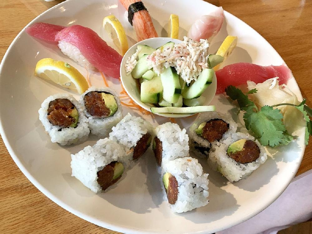 The lunchtime Spicy Tuna Combo pairs a spicy tuna roll with nigiri — in this case, tuna, snapper and surimi with an extra piece of tuna subbing for salmon — and a crab-meat topped cucumber salad.